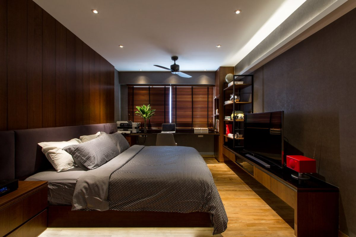 master bedroom with mahogany accent wall